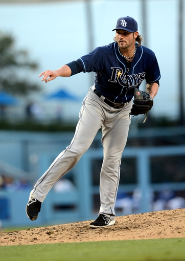 Aug 11, 2013; Los Angeles, CA, USA;    Tampa Bay Rays relief pitcher Josh Lueke (52) during the game against the Los Angeles Dodgers at Dodger Stadium. Mandatory Credit: Jayne Kamin-Oncea-USA TODAY Sports