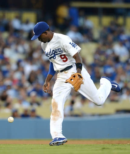 Aug 11, 2013; Los Angeles, CA, USA;   Los Angeles Dodgers shortstop Dee Gordon (9) makes a fielding error in the eighth inning of the game against the Tampa Bay Rays at Dodger Stadium. Mandatory Credit: Jayne Kamin-Oncea-USA TODAY Sports