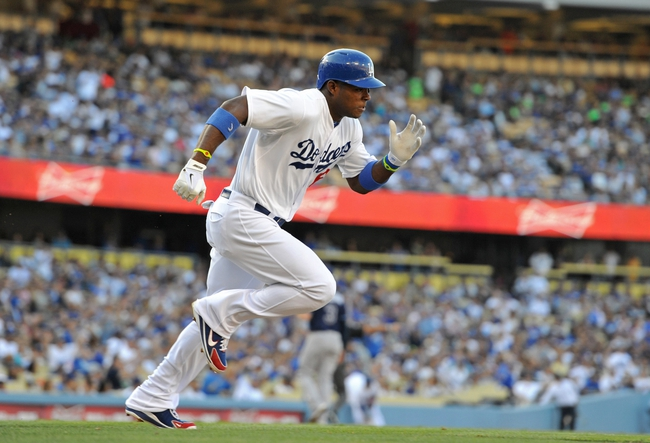 Aug 11, 2013; Los Angeles, CA, USA;   Los Angeles Dodgers right fielder Yasiel Puig (66) doubles in the third inning of the game against the Tampa Bay Rays at Dodger Stadium. Mandatory Credit: Jayne Kamin-Oncea-USA TODAY Sports