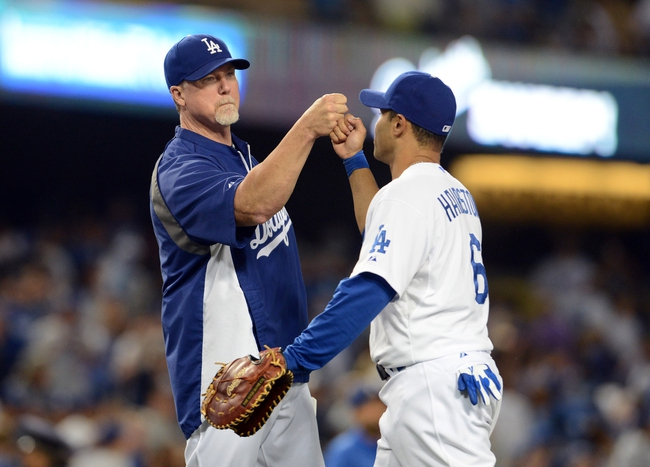 Aug 11, 2013; Los Angeles, CA, USA;   Los Angeles Dodgers third baseman Jerry Hairston Jr. (6) gets high five from batting coach Mark McGwire (12) at the end of the game against the Tampa Bay Rays at Dodger Stadium. Dodgers won 8-2. Mandatory Credit: Jayne Kamin-Oncea-USA TODAY Sports