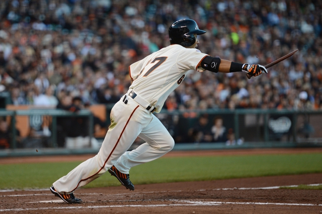 July 9, 2013; San Francisco, CA, USA; San Francisco Giants left fielder Kensuke Tanaka (37) runs to first base after breaking his bat during the third inning against the New York Mets at AT&T Park. The Mets defeated the Giants 10-6. Mandatory Credit: Kyle Terada-USA TODAY Sports