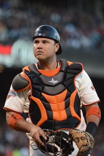 July 9, 2013; San Francisco, CA, USA; San Francisco Giants catcher Guillermo Quiroz (12) looks on during the fourth inning against the New York Mets at AT&T Park. The Mets defeated the Giants 10-6. Mandatory Credit: Kyle Terada-USA TODAY Sports