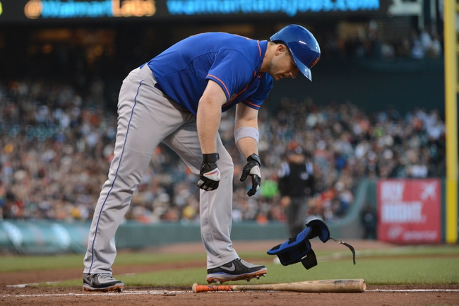 July 9, 2013; San Francisco, CA, USA; New York Mets third baseman David Wright (5) removes his shin guard after being walked during the fourth inning against the San Francisco Giants at AT&T Park. The Mets defeated the Giants 10-6. Mandatory Credit: Kyle Terada-USA TODAY Sports