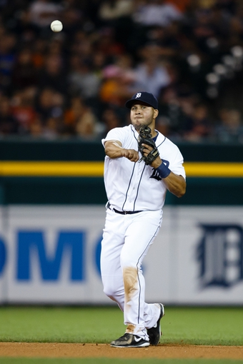 Jul 30, 2013; Detroit, MI, USA; Detroit Tigers shortstop Jhonny Peralta (27) makes a throw against the Washington Nationals at Comerica Park. Mandatory Credit: Rick Osentoski-USA TODAY Sports