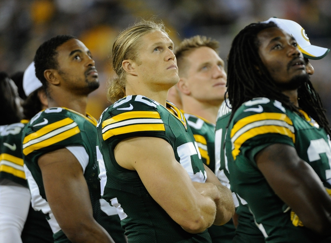 Aug 9, 2013; Green Bay, WI, USA;  Green Bay Packers linebacker Clay Matthews (center) during the game against the Arizona Cardinals at Lambeau Field. Mandatory Credit: Benny Sieu-USA TODAY Sports