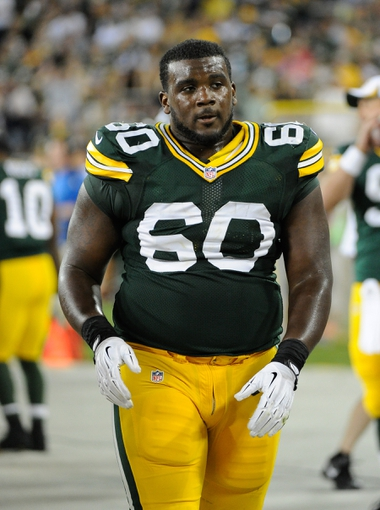 Aug 9, 2013; Green Bay, WI, USA;  Green Bay Packers center Patrick Lewis (60) during the game against the Arizona Cardinals at Lambeau Field. Mandatory Credit: Benny Sieu-USA TODAY Sports
