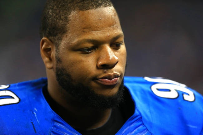 Aug 9, 2013; Detroit, MI, USA; Detroit Lions defensive tackle Ndamukong Suh (90) during a preseason game against the New York Jets at Ford Field. Mandatory Credit: Andrew Weber-USA TODAY Sports