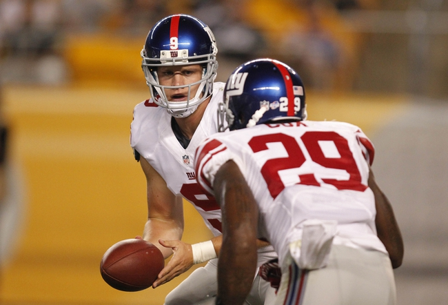 Aug 10, 2013; Pittsburgh, PA, USA; New York Giants quarterback Ryan Nassib (9) prepares to hand the ball to running back Michael Cox (29) against the Pittsburgh Steelers during the fourth quarter at Heinz Field. The New York Giants won 18-13. Mandatory Credit: Charles LeClaire-USA TODAY Sports