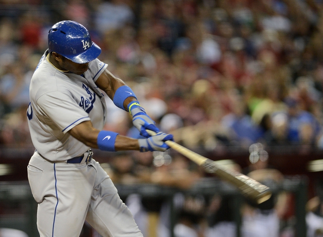 Jul 10, 2013; Phoenix, AZ, USA;  Los Angeles Dodgers outfielder Yasiel Puig (66) at bat against the Arizona Diamondbacks at Chase Field.  The Dodgers defeated the Diamondbacks 7-5 in extra innings.  Mandatory Credit: Jennifer Stewart-USA TODAY Sports