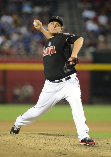 Jul 10, 2013; Phoenix, AZ, USA;  Arizona Diamondbacks pitcher David Hernandez (30) pitches against the Los Angeles Dodgers at Chase Field.  The Dodgers defeated the Diamondbacks 7-5 in extra innings.  Mandatory Credit: Jennifer Stewart-USA TODAY Sports