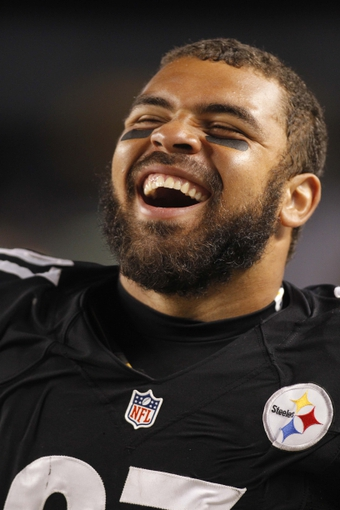 Aug 10, 2013; Pittsburgh, PA, USA; Pittsburgh Steelers defensive end Cameron Heyward (97) reacts on the sidelines against the New York Giants during the third quarter at Heinz Field. The New York Giants won 18-13. Mandatory Credit: Charles LeClaire-USA TODAY Sports