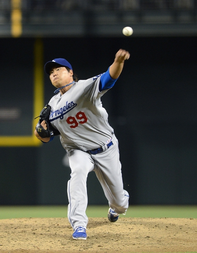 Jul 10, 2013; Phoenix, AZ, USA;  Los Angeles Dodgers pitcher Hyun-Jin Ryu (99) pitches against the Arizona Diamondbacks in the second inning at Chase Field. Mandatory Credit: Jennifer Stewart-USA TODAY Sports