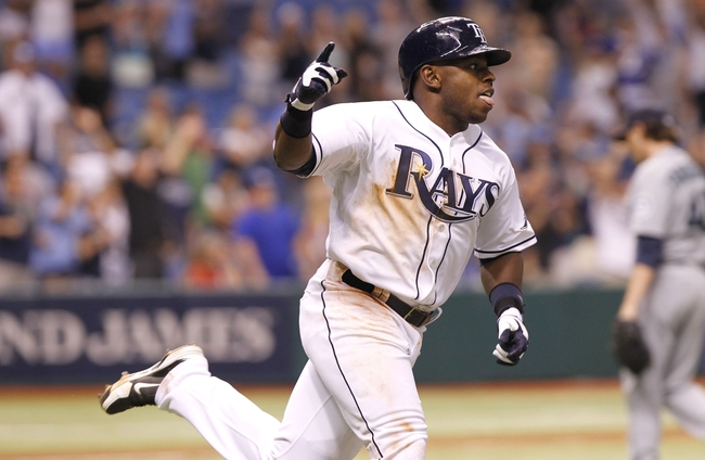 Aug 14, 2013; St. Petersburg, FL, USA; Tampa Bay Rays left fielder Jason Bourgeois (13) reacts after he hit the game winning RBI single during the ninth inning against the Seattle Mariners at Tropicana Field. Tampa Bay Rays defeated the Seattle Mariners 5-4. Mandatory Credit: Kim Klement-USA TODAY Sports