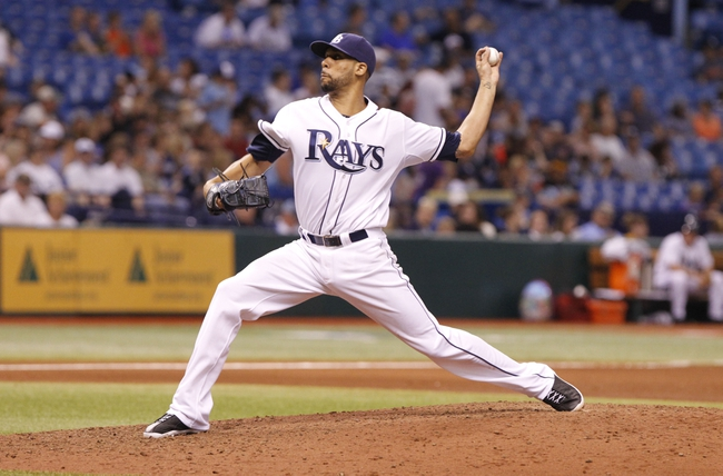 Aug 14, 2013; St. Petersburg, FL, USA; Tampa Bay Rays starting pitcher David Price (14) throws a pitch during the sixth inning against the Seattle Mariners at Tropicana Field. Tampa Bay Rays defeated the Seattle Mariners 5-4. Mandatory Credit: Kim Klement-USA TODAY Sports