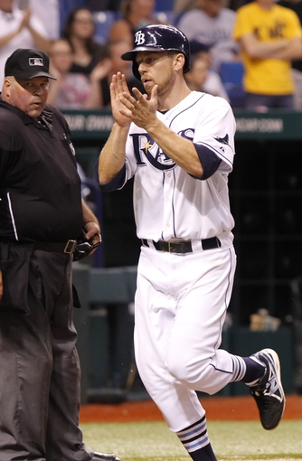 Aug 14, 2013; St. Petersburg, FL, USA; Tampa Bay Rays second baseman Ben Zobrist (18) scores a run during the ninth inning against the Seattle Mariners at Tropicana Field. Tampa Bay Rays defeated the Seattle Mariners 5-4. Mandatory Credit: Kim Klement-USA TODAY Sports