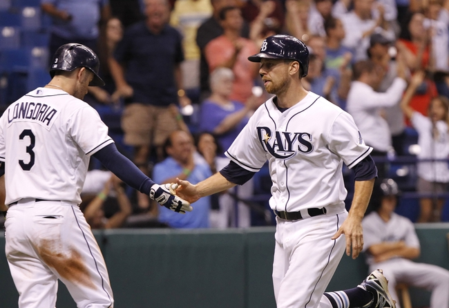 Aug 14, 2013; St. Petersburg, FL, USA; Tampa Bay Rays second baseman Ben Zobrist (18) is congratulated by Tampa Bay Rays third baseman Evan Longoria (3) after he scored a run during the ninth inning against the Seattle Mariners at Tropicana Field. Tampa Bay Rays defeated the Seattle Mariners 5-4. Mandatory Credit: Kim Klement-USA TODAY Sports