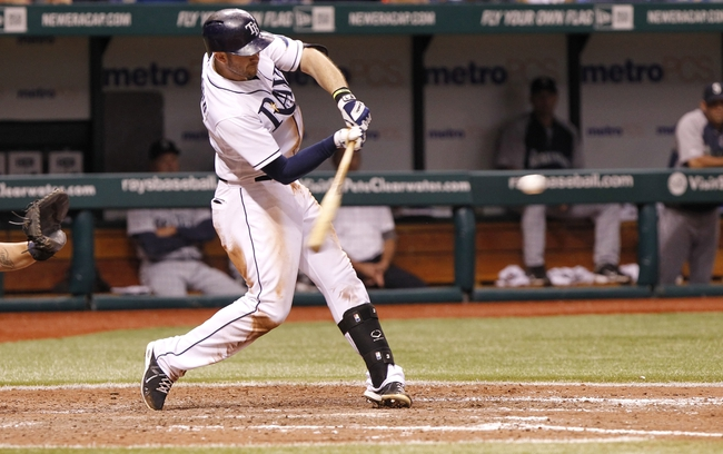 Aug 14, 2013; St. Petersburg, FL, USA; Tampa Bay Rays third baseman Evan Longoria (3) doubles during the ninth inning against the Seattle Mariners at Tropicana Field. Tampa Bay Rays defeated the Seattle Mariners 5-4. Mandatory Credit: Kim Klement-USA TODAY Sports
