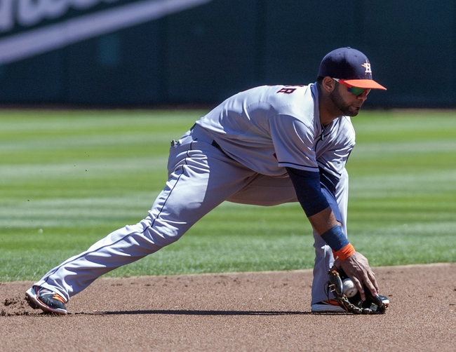 Aug 15, 2013; Oakland, CA, USA; Houston Astros shortstop Jonathan Villar (6) fields a ground ball against the Oakland Athletics during the first inning at O.Co Coliseum. Mandatory Credit: Ed Szczepanski-USA TODAY Sports