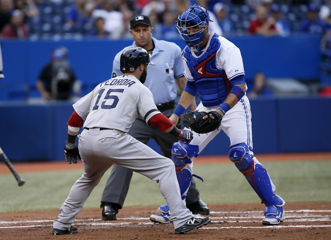 Aug 15, 2013; Toronto, Ontario, CAN; Boston Red Sox second baseman Dustin Pedroia (15) tries to get around Toronto Blue Jays catcher J.P. Arencibia (9) as home plate umpire Chris Guccione looks on during the first inning at the Rogers Centre. Mandatory Credit: John E. Sokolowski-USA TODAY Sports
