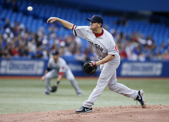 Aug 15, 2013; Toronto, Ontario, CAN; Boston Red Sox starting pitcher Jake Peavy (44) throws against the Toronto Blue Jays at the Rogers Centre. Mandatory Credit: John E. Sokolowski-USA TODAY Sports