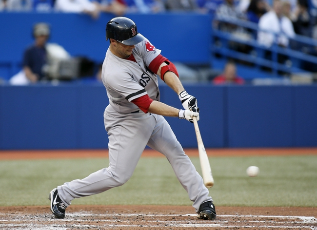 Aug 15, 2013; Toronto, Ontario, CAN; Boston Red Sox first baseman Daniel Nava (29) singles in the second inning against the Toronto Blue Jays at the Rogers Centre. Mandatory Credit: John E. Sokolowski-USA TODAY Sports