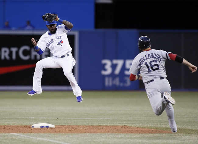 Aug 15, 2013; Toronto, Ontario, CAN; Toronto Blue Jays shortstop Jose Reyes (7) goes high to get a throw as Boston Red Sox third baseman Will Middlebrooks (16) heads for second base in the fourth inning at the Rogers Centre. Mandatory Credit: John E. Sokolowski-USA TODAY Sports