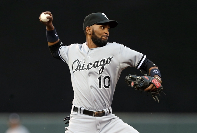Aug 15, 2013; Minneapolis, MN, USA; Chicago White Sox shortstop Alexei Ramirez (10) throws the ball to first base in the second inning against the Minnesota Twins at Target Field. Mandatory Credit: Jesse Johnson-USA TODAY Sports