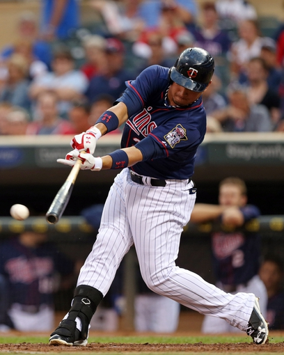 Aug 15, 2013; Minneapolis, MN, USA; Minnesota Twins left fielder Oswaldo Arcia (31) hits a single in the second inning against the Chicago White Sox at Target Field. Mandatory Credit: Jesse Johnson-USA TODAY Sports