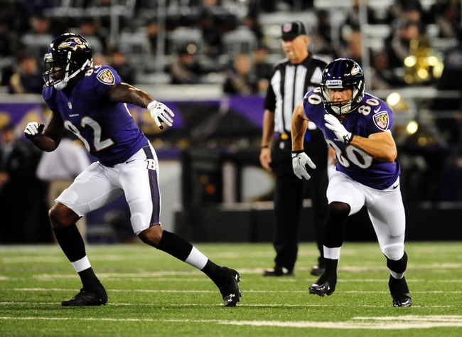 Aug 15, 2013; Baltimore, MD, USA; Baltimore Ravens wide receivers Torrey Smith (82) and Brandon Stokley (80) run a route during the game against the Atlanta Falcons at M&T Bank Stadium. Mandatory Credit: Evan Habeeb-USA TODAY Sports