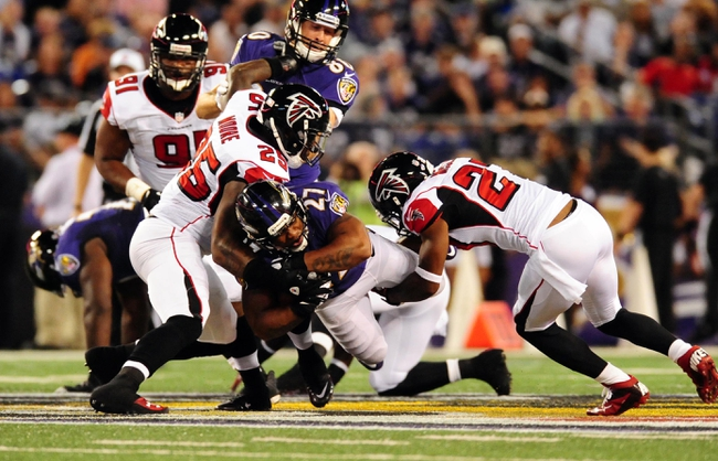 Aug 15, 2013; Baltimore, MD, USA; Baltimore Ravens running back Ray Rice (27) is tackled by safety William Moore (25) and cornerback Robert McClain (27) at M&T Bank Stadium. Mandatory Credit: Evan Habeeb-USA TODAY Sports