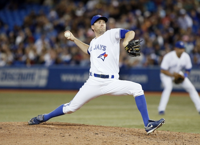 Aug 15, 2013; Toronto, Ontario, CAN; Toronto Blue Jays pitcher Casey Janssen (44) throws against the Boston Red Sox in the ninth inning at the Rogers Centre. Toronto defeated Boston 2-1. Mandatory Credit: John E. Sokolowski-USA TODAY Sports