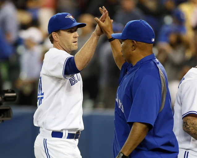 Aug 15, 2013; Toronto, Ontario, CAN; Toronto Blue Jays pitcher Casey Janssen (44) gets congratulated by bench coach DeMarlo Hale after a win aginst the Boston Red Sox at the Rogers Centre. Toronto defeated Boston 2-1. Mandatory Credit: John E. Sokolowski-USA TODAY Sports