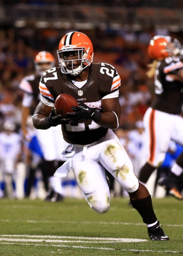 Aug 15, 2013; Cleveland, OH, USA; Cleveland Browns running back Brandon Jackson (27) runs the ball into the end zone for a touchdown in the third quarter of a preseason game against the Detroit Lions at FirstEnergy Stadium. Mandatory Credit: Andrew Weber-USA TODAY Sports