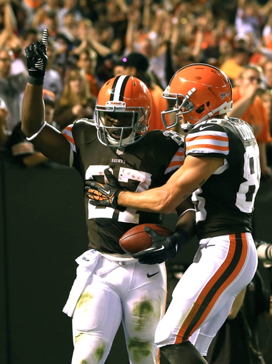 Aug 15, 2013; Cleveland, OH, USA; Detroit Lions strong safety Glover Quin (27) celebrates with Cleveland Browns wide receiver Josh Cooper (88) after scoring a touchdown in the third quarter of a preseason game against the Detroit Lions at FirstEnergy Stadium. Mandatory Credit: Andrew Weber-USA TODAY Sports