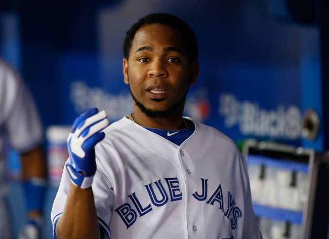 Aug 15, 2013; Toronto, Ontario, CAN; Toronto Blue Jays designated hitter Edwin Encarnacion (10) reacts after scoring the winning run in the eighth inning against the Boston Red Sox at the Rogers Centre. Toronto defeated Boston 2-1. Mandatory Credit: John E. Sokolowski-USA TODAY Sports