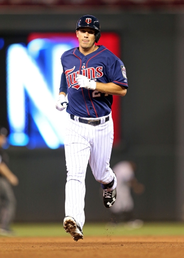 Aug 15, 2013; Minneapolis, MN, USA; Minnesota Twins third baseman Trevor Plouffe (24) rounds second base after hitting a home run in the fifth inning against the Chicago White Sox at Target Field. Mandatory Credit: Jesse Johnson-USA TODAY Sports