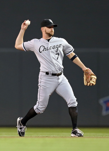 Aug 15, 2013; Minneapolis, MN, USA; Chicago White Sox second baseman Jeff Keppinger (7) throws the ball to first base in the fourth inning against the Minnesota Twins at Target Field. Mandatory Credit: Jesse Johnson-USA TODAY Sports