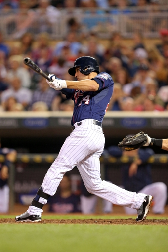 Aug 15, 2013; Minneapolis, MN, USA; Minnesota Twins third baseman Trevor Plouffe (24) hits a home run in the fifth inning against the Chicago White Sox at Target Field. Mandatory Credit: Jesse Johnson-USA TODAY Sports