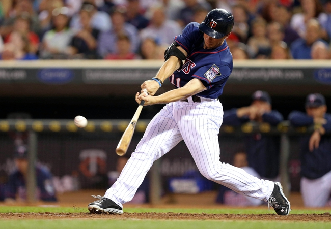 Aug 15, 2013; Minneapolis, MN, USA; Minnesota Twins center fielder Clete Thomas (11) hits a single in the fifth inning against the Chicago White Sox at Target Field. Mandatory Credit: Jesse Johnson-USA TODAY Sports