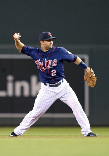 Aug 15, 2013; Minneapolis, MN, USA; Minnesota Twins second baseman Brian Dozier (2) throws the ball to first base in the sixth inning against the Chicago White Sox at Target Field. Mandatory Credit: Jesse Johnson-USA TODAY Sports