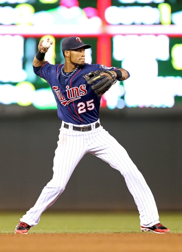 Aug 15, 2013; Minneapolis, MN, USA; Minnesota Twins shortstop Pedro Florimon (25) throws the ball to first base in the sixth inning against the Chicago White Sox at Target Field. Mandatory Credit: Jesse Johnson-USA TODAY Sports