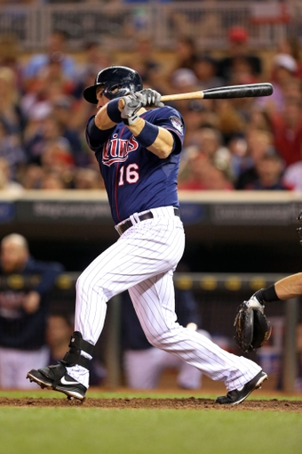 Aug 15, 2013; Minneapolis, MN, USA; Minnesota Twins designated hitter Josh Willingham (16) hits a RBI single in the sixth inning against the Chicago White Sox at Target Field. Mandatory Credit: Jesse Johnson-USA TODAY Sports
