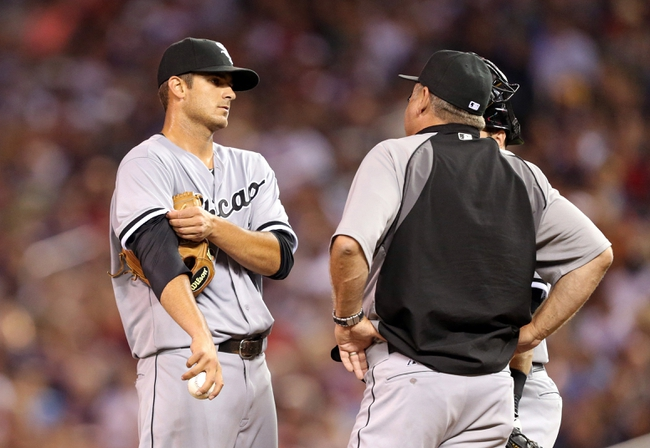 Aug 15, 2013; Minneapolis, MN, USA; Chicago White Sox pitching coach Don Cooper talks to Chicago White Sox starting pitcher Andre Rienzo (64) in the sixth inning against the Minnesota Twins at Target Field. Mandatory Credit: Jesse Johnson-USA TODAY Sports