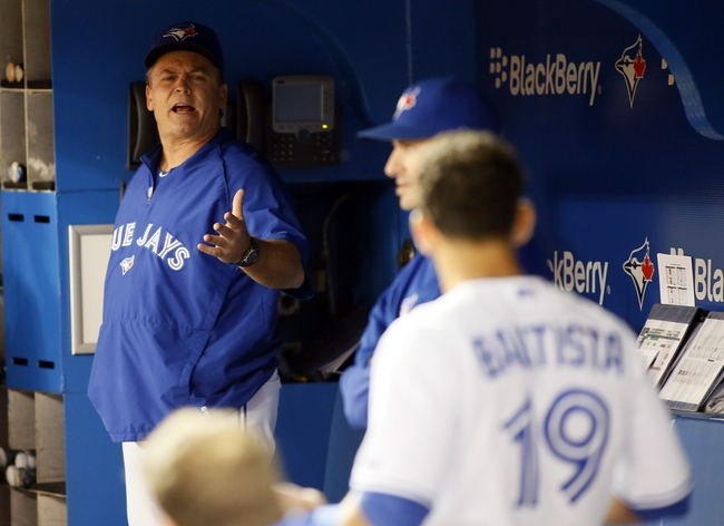 Aug 15, 2013; Toronto, Ontario, CAN; Toronto Blue Jays manager John Gibbons and right fielder Jose Bautista (19) exchange words in the dugout in the seventh inning against the Boston Red Sox at the Rogers Centre. Toronto defeated Boston 2-1. Mandatory Credit: John E. Sokolowski-USA TODAY Sports