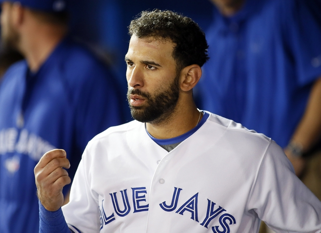 Aug 15, 2013; Toronto, Ontario, CAN; Toronto Blue Jays right fielder Jose Bautista (19) after scoring a run in the seventh inning against the Boston Red Sox at the Rogers Centre. Toronto defeated Boston 2-1. Mandatory Credit: John E. Sokolowski-USA TODAY Sports