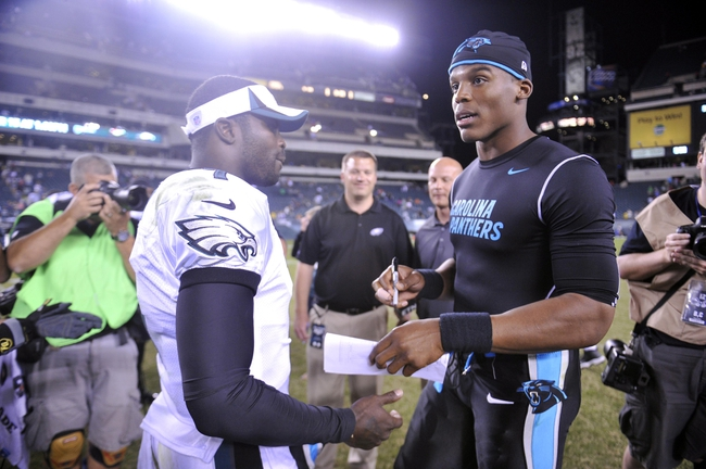 Aug 15, 2013; Philadelphia, PA, USA; Carolina Panthers quarterback Cam Newton (1) and Philadelphia Eagles quarterback Michael Vick (7) talk after the second half at Lincoln Financial Field. The Eagles won the game 14-9. Mandatory Credit: Joe Camporeale-USA TODAY Sports