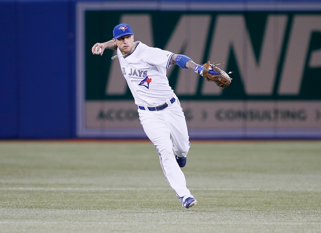 Aug 15, 2013; Toronto, Ontario, CAN; Toronto Blue Jays third baseman Brett Lawrie (13) throws out Boston Red Sox left fielder Jonny Gomes (not pictured) in the fifth inning at the Rogers Centre. Toronto defeated Boston 2-1. Mandatory Credit: John E. Sokolowski-USA TODAY Sports