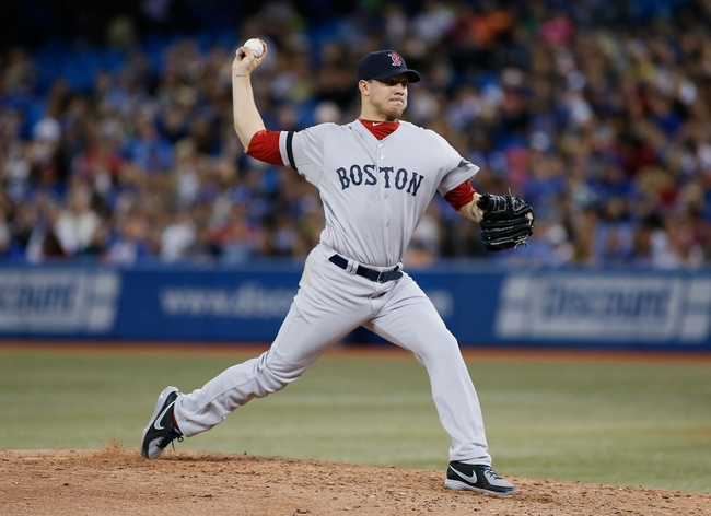 Aug 15, 2013; Toronto, Ontario, CAN; Boston Red Sox starting pitcher Jake Peavy (44) throws against the Toronto Blue Jays in the fifth inning at the Rogers Centre. Toronto defeated Boston 2-1. Mandatory Credit: John E. Sokolowski-USA TODAY Sports