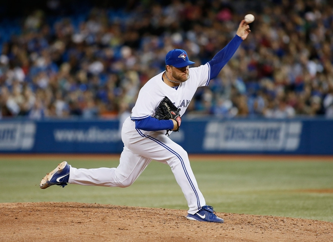 Aug 15, 2013; Toronto, Ontario, CAN; Toronto Blue Jays pitcher Mark Buehrle (56) throws against the Boston Red Sox in the sixth inning at the Rogers Centre. Toronto defeated Boston 2-1. Mandatory Credit: John E. Sokolowski-USA TODAY Sports