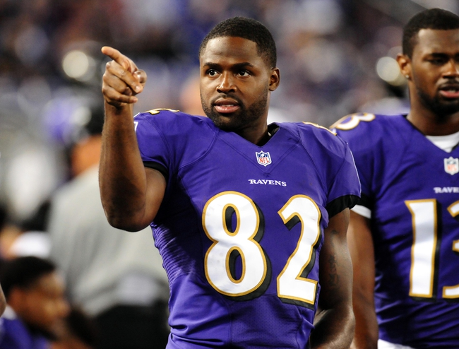 Aug 15, 2013; Baltimore, MD, USA; Baltimore Ravens wide receiver Torrey Smith (82) points to some fans during the game against the Atlanta Falcons at M&T Bank Stadium. Mandatory Credit: Evan Habeeb-USA TODAY Sports
